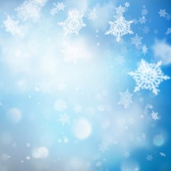 Sfondo di natale con luci e fiocchi di neve.