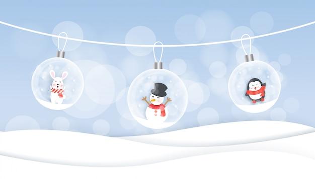Sfondo di natale con pupazzo di neve, coniglio e pinguino in carta tagliata e stile artigianale.