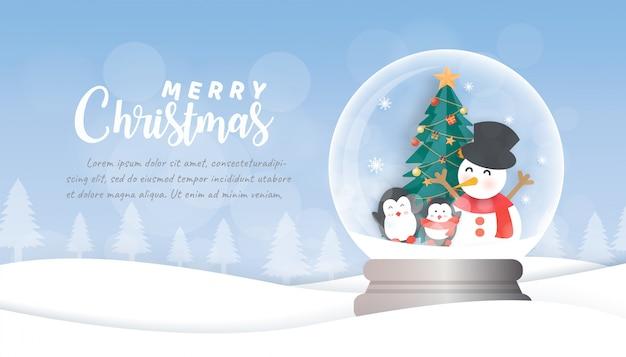 Sfondo di natale con pupazzo di neve e pinguini nel globo di neve