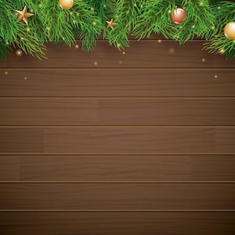 Sfondo di natale con ramo di abete su legno marrone e spazio per il testo