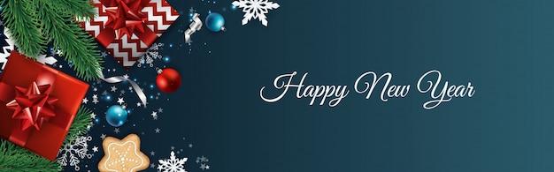 Sfondo di natale, design biglietto di auguri, banner, poster, confezione regalo vista dall'alto, palle di decorazione di natale e fiocchi di neve,