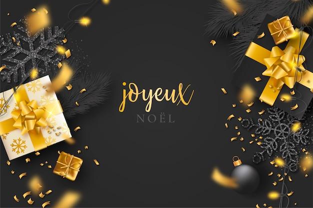 Sfondo di natale nero con coriandoli e regali d'oro