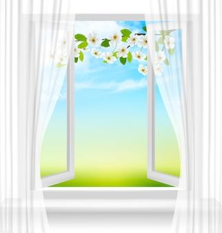 Sfondo di natura con finestra aperta e fiore di primavera di ciliegia.