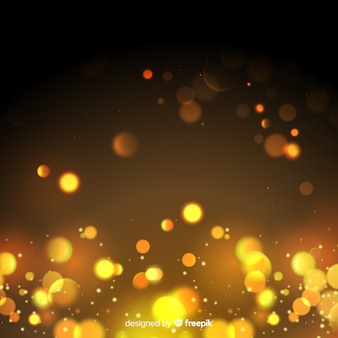 Sfondo di particelle d'oro in stile bokeh