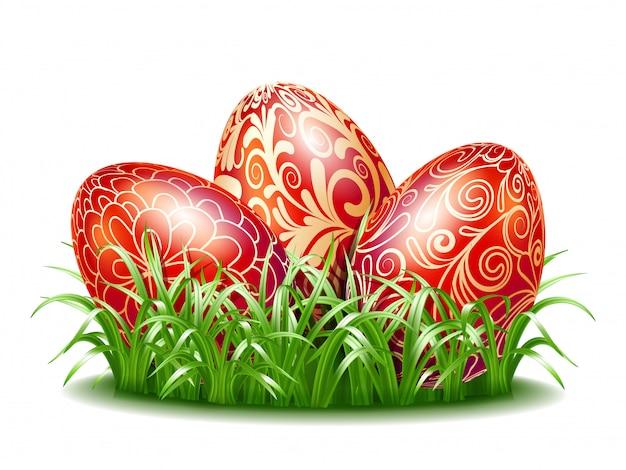 Sfondo di pasqua con tre uova rosse in erba