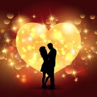 Sfondo di san valentino con silhouette di una coppia di innamorati su un disegno del cuore