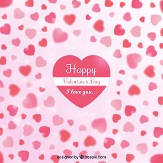 Sfondo di san valentino di cuori in toni rosa e l'effetto bokeh
