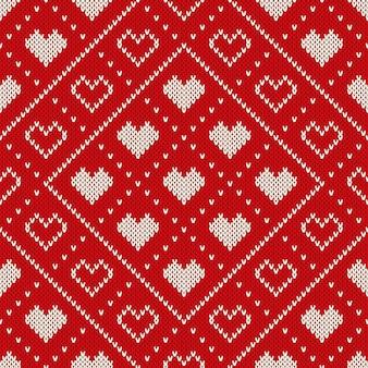 Sfondo di san valentino. reticolo lavorato a maglia senza giunte con i cuori