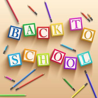 Sfondo di scuola elementare con matite colorate e cubi