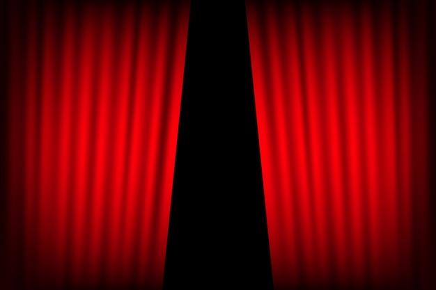 Sfondo di tende di intrattenimento per film. il bello teatro rosso ha piegato le tende sulla tenda sul palco nero.