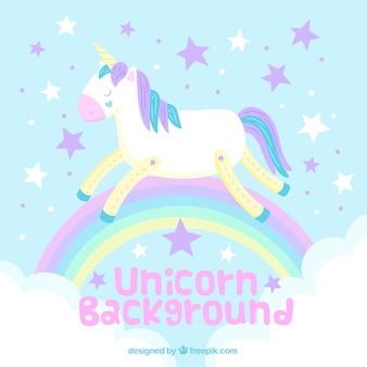 Sfondo di unicorno e arcobaleno in colori pastello