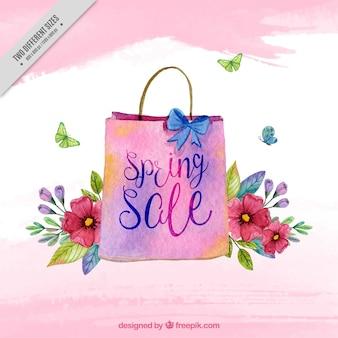 Sfondo di vendita con il sacchetto e acquerello fiori