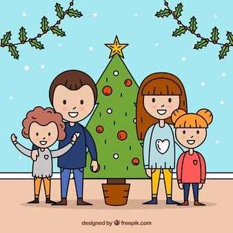 Sfondo disegnato a mano con una famiglia accanto ad un albero di natale