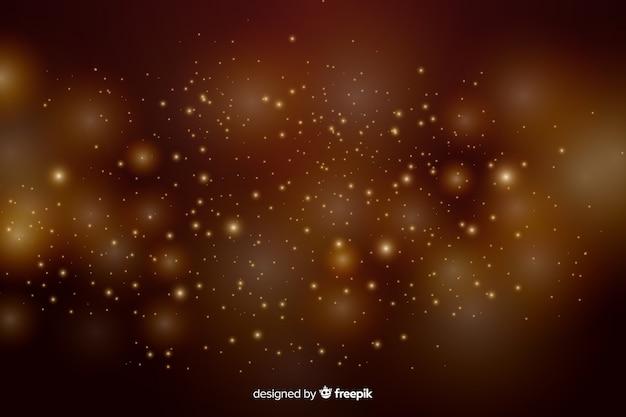 Sfondo dorato con particelle d'oro