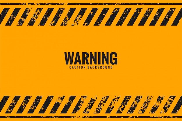 Sfondo giallo di avvertimento con linee di strisce nere