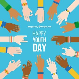 Sfondo giornata della gioventù con le mani piatte
