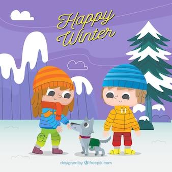 Sfondo invernale felice con bambini carini e un cane