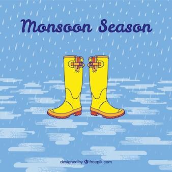 Sfondo monsone con stivali da pioggia