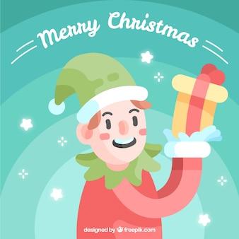 Sfondo natale con un elfo che tiene un regalo