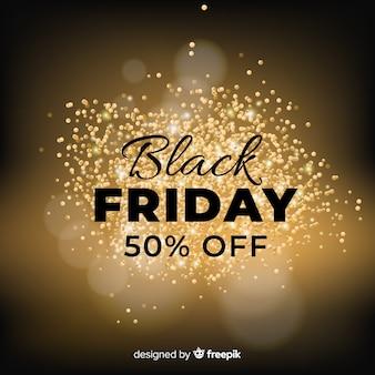 Sfondo nero vendita di venerdì con glitter dorati