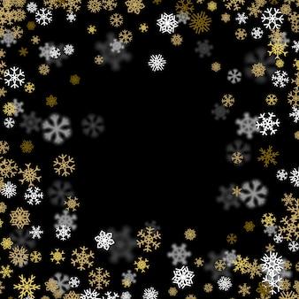 Sfondo nevicata con fiocchi di neve dorati offuscata nel buio