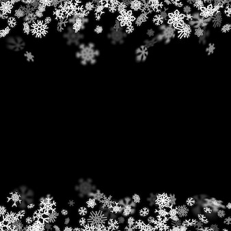 Sfondo nevicata con fiocchi di neve offuscata al buio