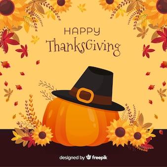 Sfondo piatto del ringraziamento con zucca e cappello