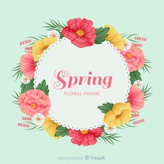 Sfondo primavera semplicistico con cornice floreale
