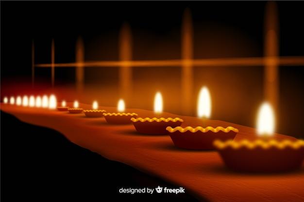 Sfondo realistico di diwali con candele