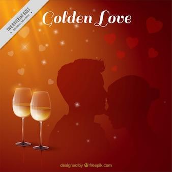 Sfondo romantico con bicchieri di vino e la silhouette della coppia