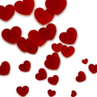 Sfondo romantico con cuori di carta rossa