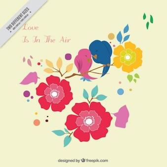 Sfondo romantico con uccelli e fiori colorati