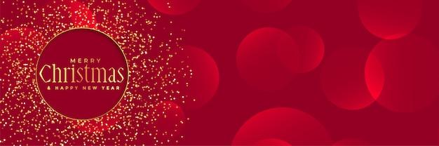 Sfondo rosso con glitter dorati per il festival di natale