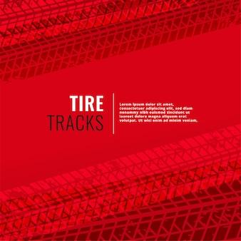 Sfondo rosso con tracce di pneumatici stampa segni