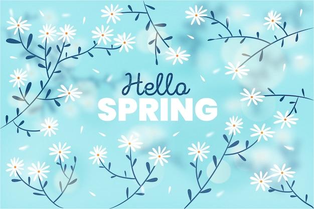 Sfondo sfocato primavera con rami e fiori