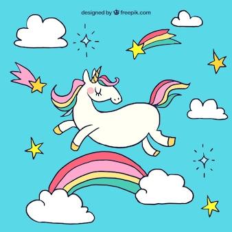 Sfondo unicorno con arcobaleno disegnato a mano