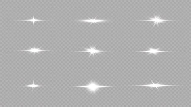 Shine starlight isolato su sfondo trasparente. effetto luce incandescente set di lampi, luci e scintillii su uno sfondo trasparente. bagliori e riflessi dorati luminosi.