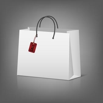 Shopper in carta bianca con etichetta di vendita.