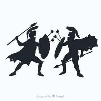 Silhouette di guerrieri spartani che combattono