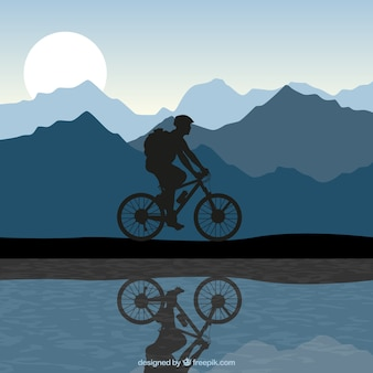 Silhouette di un uomo in sella a una bici