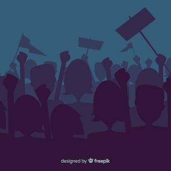 Silhouette folla di persone con bandiere e striscioni in una manifestazione
