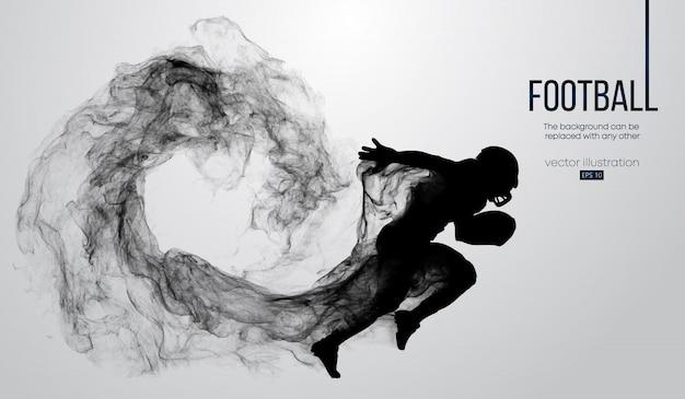 Siluetta astratta di un giocatore di football americano su priorità bassa bianca da particelle, polvere, fumo, vapore. giocatore di football in esecuzione con la palla. rugby.