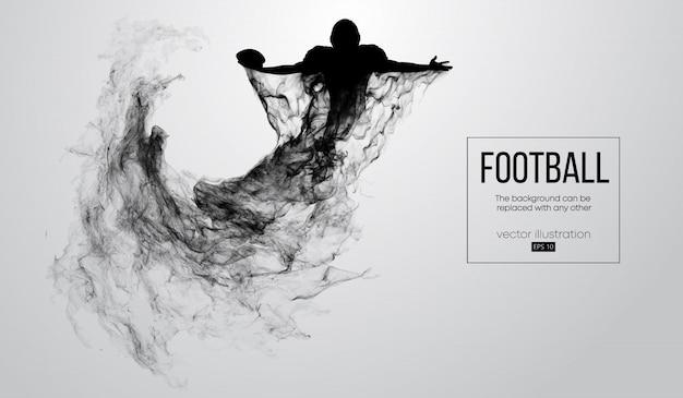 Siluetta astratta di un giocatore di football americano su priorità bassa bianca da particelle, polvere, fumo, vapore. il giocatore di football tiene la palla, vincitore. rugby.