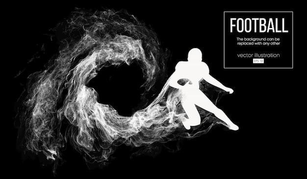 Siluetta astratta di un giocatore di football americano su sfondo nero scuro da particelle, polvere, fumo, vapore. giocatore di football in esecuzione con la palla. rugby.