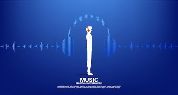 Siluetta dell'uomo con la cuffia e l'equalizzatore di musica dell'onda sonora. cuffia audiovisiva con stile grafico a onda di linea