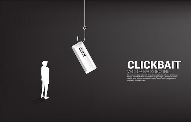 Siluetta dell'uomo d'affari che sta con l'amo di pesca con il bottone di clic. concetto di click bait e phishing digitale.