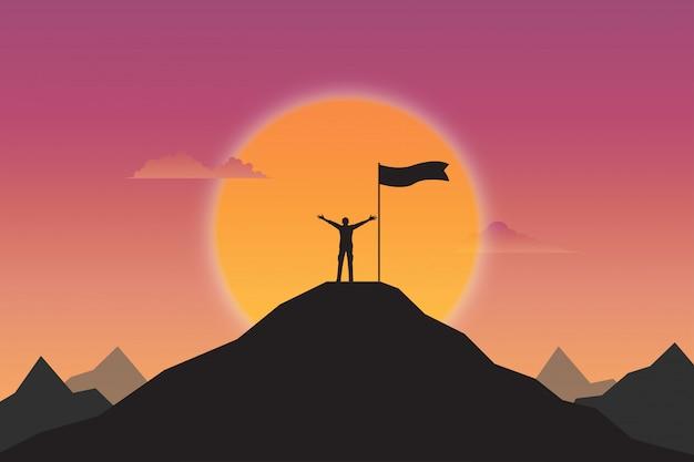 Siluetta dell'uomo d'affari e bandiera sulla montagna superiore