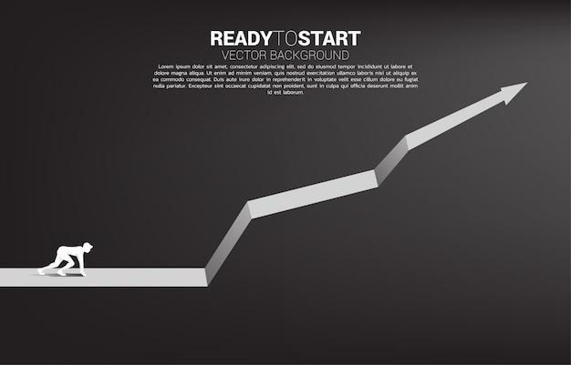 Siluetta dell'uomo d'affari pronta a correre dalla linea di partenza sul modello di grafico crescente