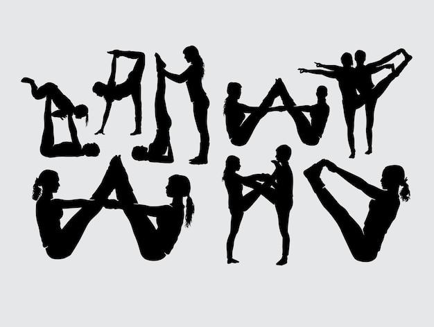 Siluetta femminile dell'addestramento della femmina e delle coppie di forma fisica