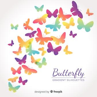 Siluette della farfalla di gradiente che volano
